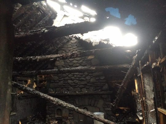 """The Stone Hut on Mount Mansfield's """"Nose"""" is seen after a Christmas Eve fire was extinguished."""