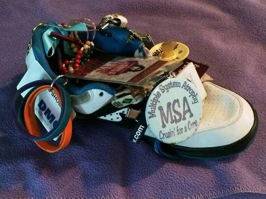 The MSA Shoe, decorated in mementos from patients and their loved ones, raises awareness of multiple system atrophy, a neurological disorder.