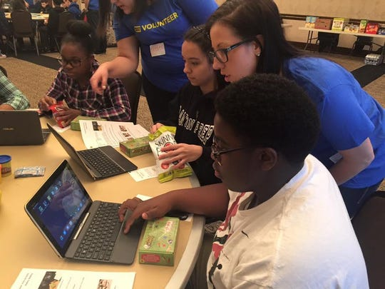 B.L.O.C.K. participants work with volunteers during the recent program focusing on technology.