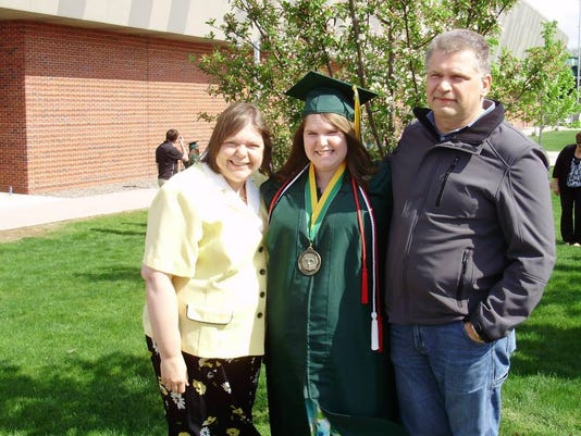 Me at college graduation with my parents!