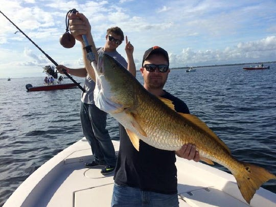 A couple of happy anglers fishing for bull redfish last November in Pensacola Bay with Captain Tyler Massey of Hot Spots Charters.