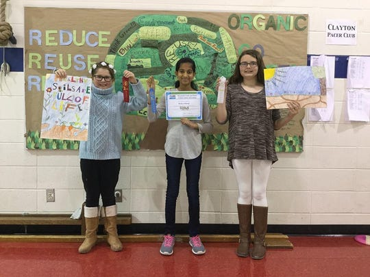 Clayton Elementary School students, from left, Samantha Hooyman (second place), Ramaya Khelgi (first) and Addison Cook (third) were the top three finishers in the Winnebago County Conservation Awareness Poster Contest. Khelgi will advance to the state competition.