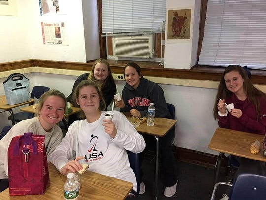 Ursuline students, from left, front row, Abby Laramore, Lindsay Brown and, back row, Megan Roesser, Annie Wills and Ellie Brutsche learnend about entrepreneurship from alumnae.
