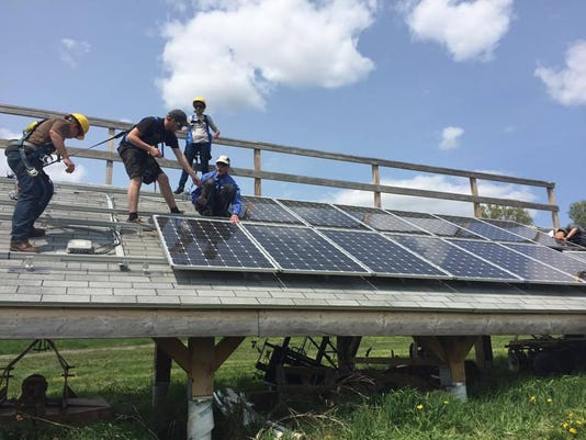 UVM students practice installing solar panels.jpg