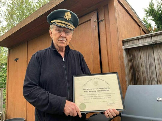 Robert El Henicky holds an honor he earned in Germany in 1964. He now has an honorary high school diploma to hang beside it.