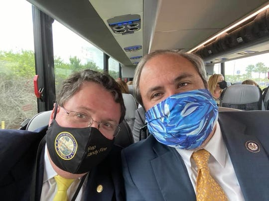 Florida GOP Chair Joe Gruters, right, and state Rep. Randy Fine wear masks during recent travel. Gruters says he tries to wear a mask in public settings such as grocery stores, but believes the decision to require masks should be left up to individual businesses. He opposes a statewide mandatory mask requirement.