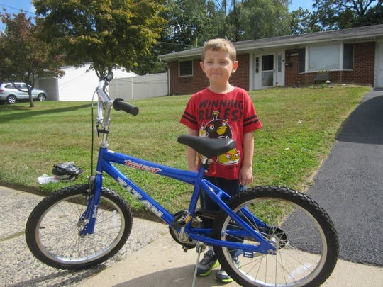 Jake, a Kendall Park resident, poses with the bike donated by the Ashley Lauren Foundation.