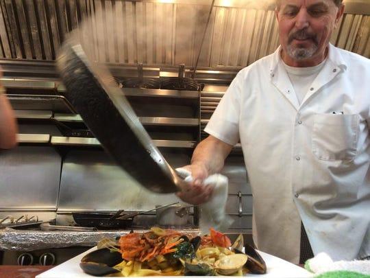 Owner Andrea Esposito Costagliola is shown in the kitchen