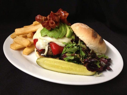 Danny Murphy, owner of Danny's Steak House & Sushi, is moving toward using grass-fed beef and lamb in his burgers.