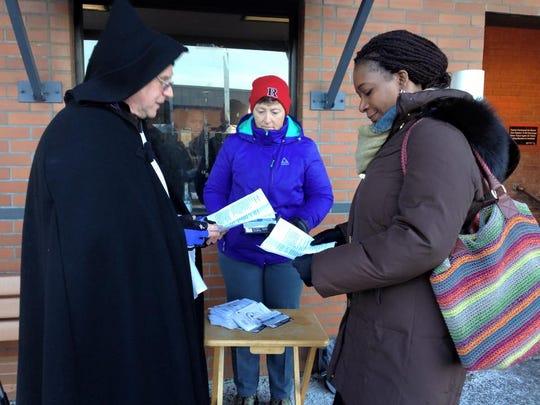 The Rev. Jack Zamboni, Rector, St. Francis' Episcopal Church in Dunellen, administers ashes at the train station in Ash Wednesday.