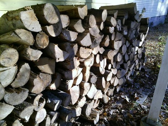 The completed woodpile outside Paula Nulty's home in White River Junction.