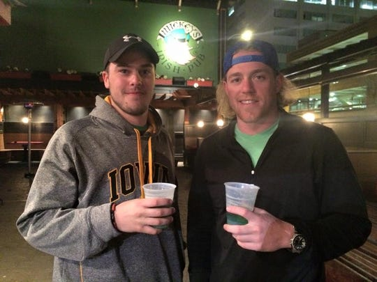 Davis Lowenberg and Zach Jones, both 21-year-old students at AIB College of Business, drink green beers at Mickey's Irish Pub, 206 Third St. in Des Moines, on Tuesday morning.