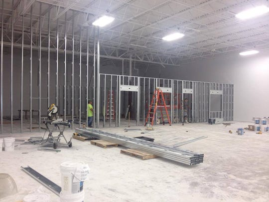 Currently under construction, the new location for ReStore, 65 W. Scott St., should be open in September. Recently framing for office space in the rear of the store was installed.