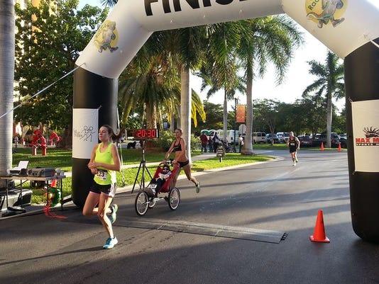 Tour_DeCape_2015_charyse_finish_line_w_Kayla.jpg