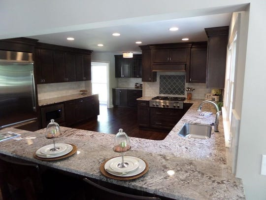 Polished Bianco Antico granite gives this countertop the shine that many homeowners love. Local Realtors agree that granite is one of the more affordable ways to increase your home's value.