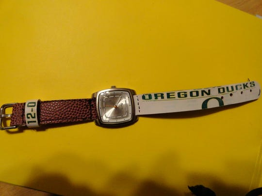 Ute fan Carrie Farrell made this watch from a football commemorating Oregon's 12-0 season. She gave it to her Ducks-loving father-in-law, Randy Ball of Salem, for Christmas.