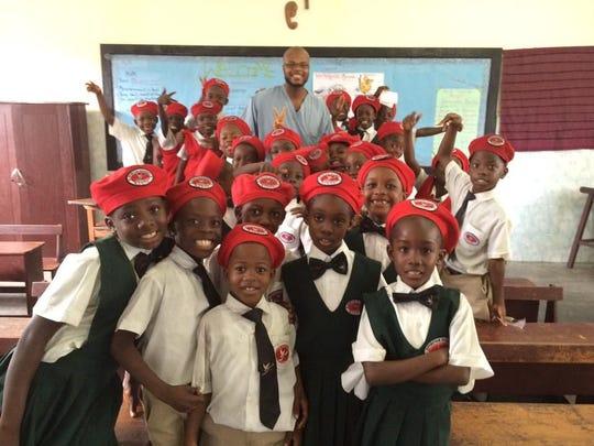 Dr. Antonio Webb, with students at the Spiritan Catholic Academy in Monrovia, Liberia, in 2014.