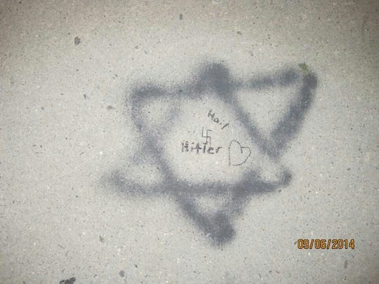 An image of some of the graffiti found on a Spring Valley sidewalk.