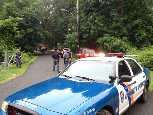 Police near the scene of a plane crash on Cottage Avenue in Purchase on June 13, 2014.