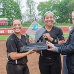 Binghamton University pitcher Sarah Miller receives the Most Outstanding Player for the 2015 America East Conference Tournament at Stony Brook University from the conference's director of communications Sean Tainsh.