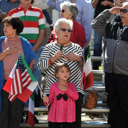 Trinity Touzert, 3, stands for the national anthems
