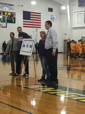 Left to right: Gill St. Bernard's athletic director Tim Davis, Dom Hoffman, Trish Hoffman and Mergin Sina at the court dedication.