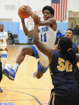 Dover's Michael Douglas gets some air while driving for the basket as Dover HS played Friendship Collegiate Academy from Washington, D.C. at the Slam Dunk to the Beach held at Cape Henlopen HS near Lewes on Monday December 28th.