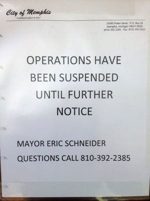 A sign hanging Friday, Jan. 29 at the door of the Memphis Police Department, states the services have been suspended.