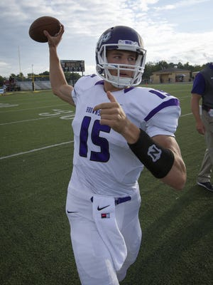 Brownsburg's Hunter Johnson (15) warms up on the field during pre-game activities Sept. 11, 2015.