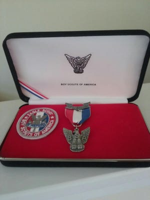 A medal and patch were among the Eagle Scout mementos found by a Mason man.