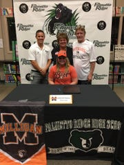 Palmetto Ridge softball player Savannah Nocera announced her signing with Milligan College (Tenn.) in a ceremony at the school Wednesday. Pictured with Nocera is her coach Brian Creel, back left, and parents Mary and Robert Creel.