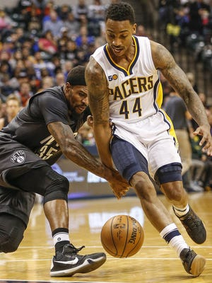 Indiana Pacers guard Jeff Teague (44) strips the ball from Brooklyn Nets forward Trevor Booker (35) in the first half at Bankers Life Fieldhouse on Thursday, Jan. 5, 2017.