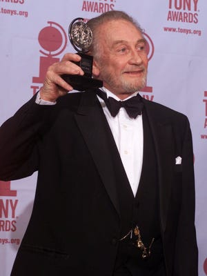 """Roy Dotrice poses with his Tony award for Best Featured Actor in a Play for his work in """"A Moon For The Misbegotten"""" on June 4, 2000, in New York."""