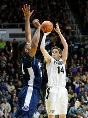 Purdue guard Ryan Cline drains a 3-pointer over Julian Moore of Penn State during a 76-73 victory last season.