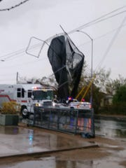 A trampoline hangs from power lines outside of a Mesa