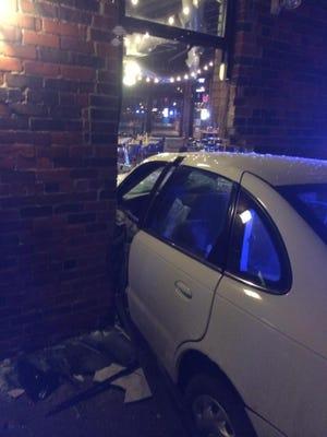 A car crashed into popular Des Moines coffee shop Smokey Row.