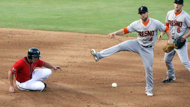 Fresno shortstop Nolan Fontana, 4, fires to first base after forcing out Hunter Renfroe, left, of the El Paso Chihuahuas at second Friday night at Southwest University Park. At right is Fresno second baseman Danny Worth, 8.