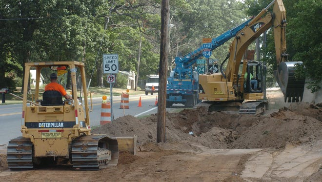 In this August 2008 photo, construction crews upgrade water and sanitary sewer lines along East Michigan Avenue to the FireKeepers Casino Hotel site in Emmett Township.