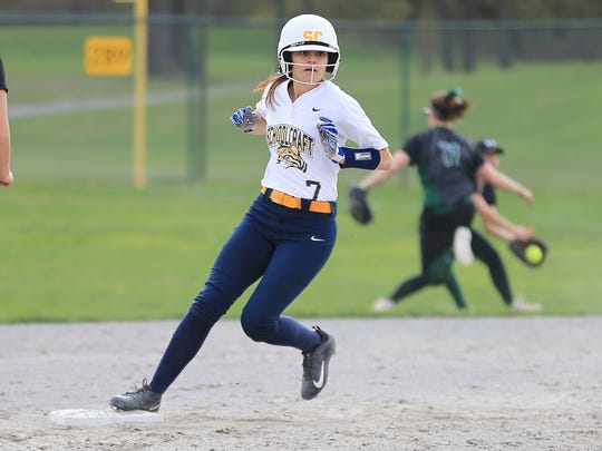 Rounding second base for Schoolcraft during Saturday's