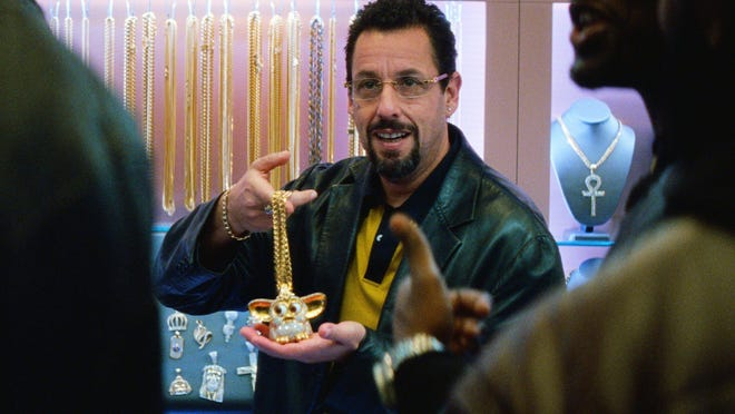 "Adam Sandler in a scene from ""Uncut Gems"" in which he plays a New York City jeweler with a serious sports gambling problem. The movie also includes former NBA star Kevin Garnett and is playing this weekend at the Stonzek Studio in Lake Worth Beach."