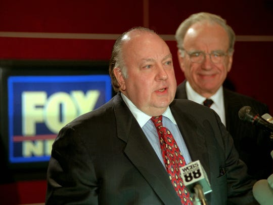 Roger Ailes speaks at a news conference with Rupert