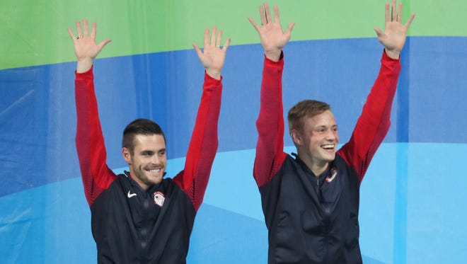 David Boudia and Steele Johnson (USA) on the podium after the men's 10-meter platform synchronized diving final in the Rio 2016 Summer Olympic Games at Maria Lenk Aquatics Centre.