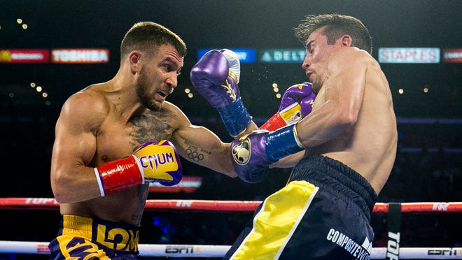 Vasiliy Lomachenko, left, hits Anthony Crolla during his knockout victory at Staples Center on April 12.