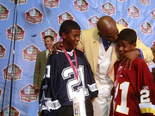 JOHN DAVID EMMETT/The News-Press....... Deion Sanders celebrates with his sons, Shilo, 11, left, and Shedeur, 9, after being enshrined into the Pro Football Hall of Fame in Canton, Ohio on Saturday August 6, 2011.