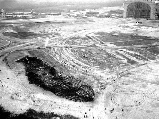An aerial shot of the crash site several days after the crash showing the scorched earth and debris from the accident.