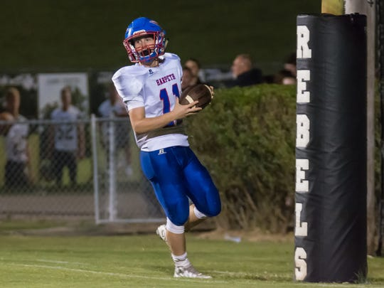 Harpeth's Luke Gossett scores one of his two touchdowns