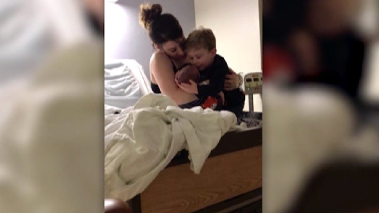 The heart-melting moment a toddler meets his little brother