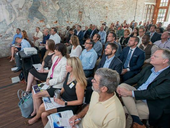 Civic and business leaders listen to Chuck Marohn speak