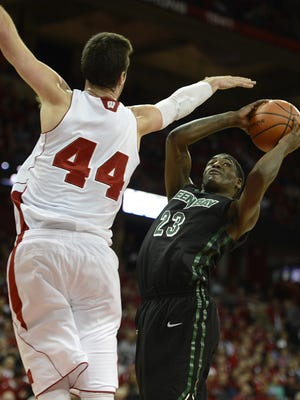 UWGB's Daeshon Francis (23) tries to take a shot past Wisconsin's Frank Kaminsky (44) in the second half at the Kohl Center in Madison.