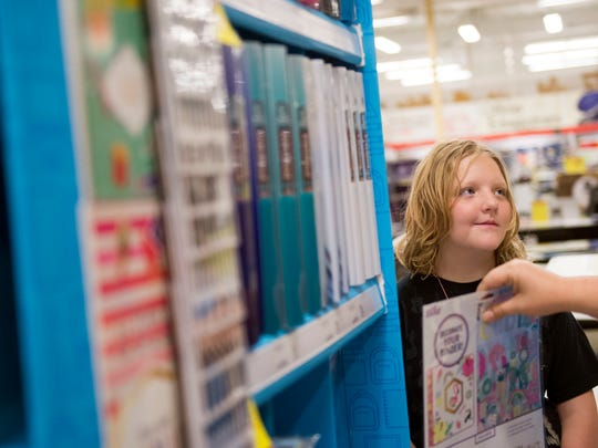 Trinity Lovegrove, 10, shops with school supplies with her mother and grandmother at Office Depot on Monday, July 17, 2017.